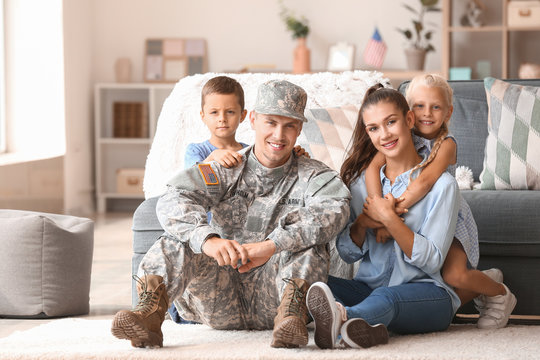 Happy military man with his family at home