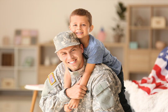 Happy military man with his son at home