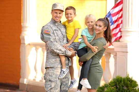 Happy military man with his family outdoors