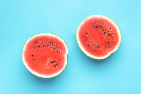 Fresh sliced watermelon isolated on blue background