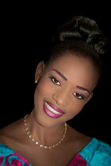 Portrait of a beautiful young bride smiling, evening makeup, black background