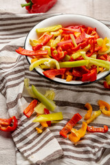 Sliced yellow and red bell pepper