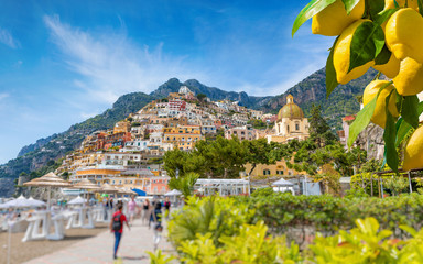 Canvas Prints Mediterranean Europe Beautiful Positano with comfortable beaches on Amalfi Coast in Campania, Italy. Ripe yellow lemons in foreground.