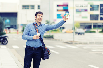 Man passenger using mobile taxi app waiting cab or ride share with hand up  Fototapete