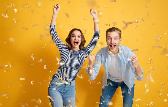 joyful couple on yellow background
