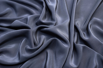 The texture of the silk fabric is gray. Background, pattern.
