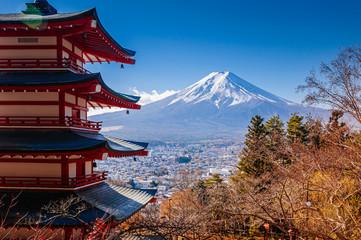 Red Chureito Pagoda and Snow covered Mount Fuji blue sky in autumn. Shimoyoshida - Fujiyoshida