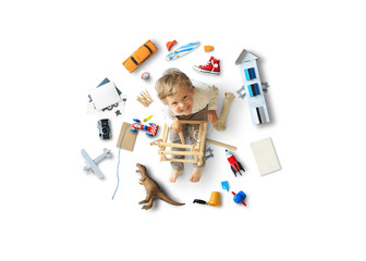 Fotomurales - Little boy sits and plays on the floor among his toys
