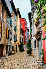 Fototapete - Colorful cobblestone street in the beautiful Old Town of Rovijn, Croatia