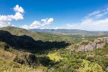 Beautiful aerial view of Serra do Cipo in Minas Gerais with forests and mountains in sunny summer day with blue sky. Landscape of the Brazilian Cerrado, one of the most devastated biomes. Wall mural