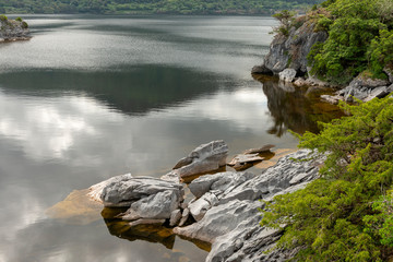 Zelfklevend Fotobehang Chocoladebruin Exposed limestone rock formations in low water level at Kilbeg Bay Muckross Lake in Killarney National Park, County Kerry, Ireland