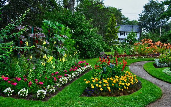 Colorful Annapolis Royal Formal Garden Beds with Building