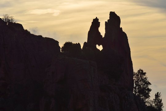 Heart-shaped hole in a rock in the Calanche, in Porto, Corsica, France, Europe