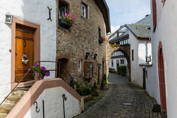 alley in the old village Kronenburg in the Eifel region, Germany