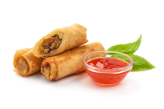 Fried Chinese Traditional Spring rolls with sweet chili sauce, isolated on white background