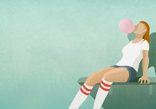 Girl blowing large bubble gum bubble