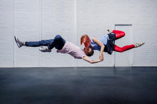 Aerial dancers dancing in studio