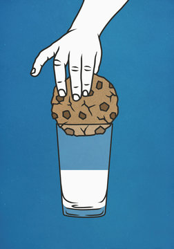 Hand trying to dip large cookie into glass of milk