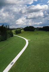 Road with nice S curve in the countryside at summer