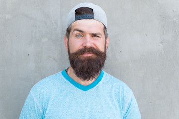 Cool hipster with beard wear stylish cap. Male beauty. Barber salon and facial hair care. Hipster lifestyle. Brutal handsome mature hipster man. Bearded man trendy style. Beard and mustache grooming