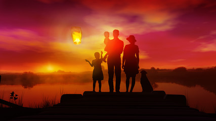 Wall Murals Nasa Family with children watches on launched Chinese lantern at sunset