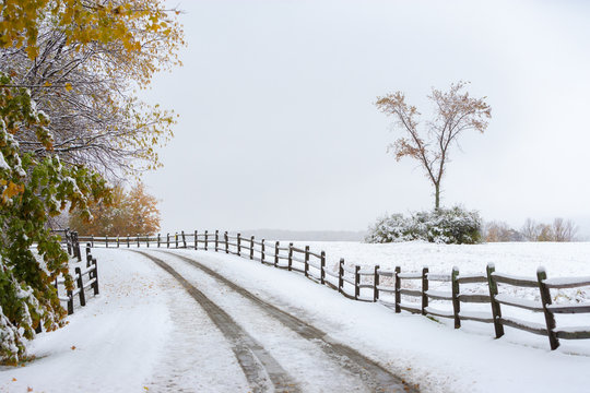 Snow covered road with autumn trees, Stowe Vermont, USA
