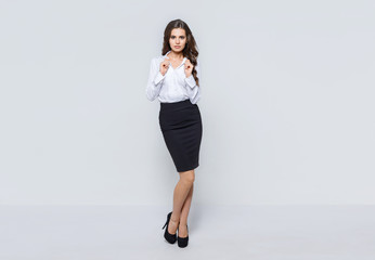 Portrait of young modern business woman. Attractive female business leader in smart casual wear. Office worker. Gray background.