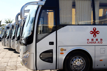 Buses gifted from China for the Pacific Games are parked at a Beijing-refurbished aquatic centre in Apia