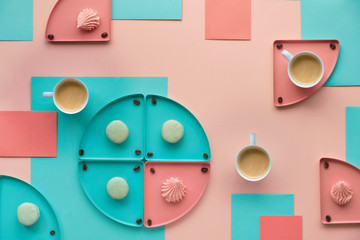 Geometric paper background in mint and coral colors with coffee and sweets