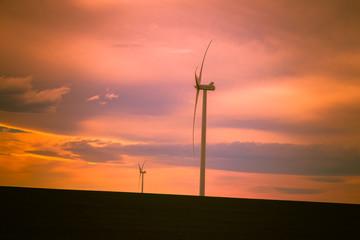 Wind Turbines Against a Beautiful Sunset