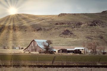 Sun Overlooking Farm Below the Hill