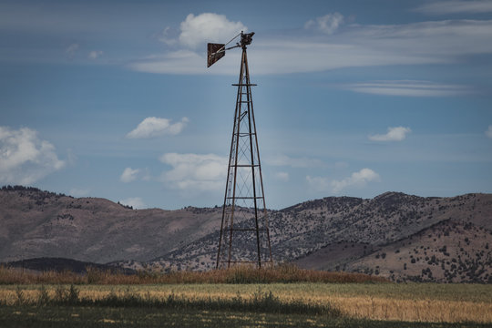 Vintage Windmill Stands in Rural Field