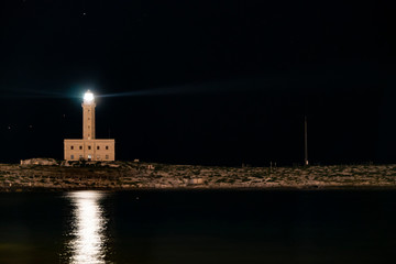 Lighthouse at night, double light. Viste, Italy