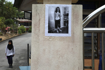 A photo of 15-year-old Irish girl Nora Anne Quoirin who went missing from a resort, is displayed on a wall at a school in Seremban.