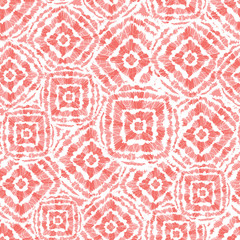 Vector coral pink shibori diamond and squares overlap pattern. Suitable for textile, gift wrap and wallpaper.