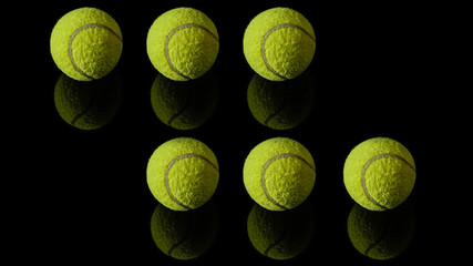 1 one green tennis ball isolated in black with reflection below it