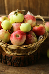 organic apples in a wicker basket on the table