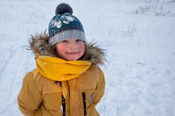 happy boy in snow play and smile sunny day outdoors