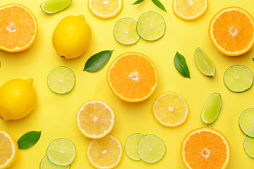 Different sliced citrus fruits on color background