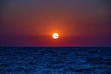 Orange sunset sea horizon view at sunset