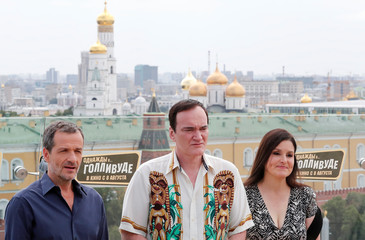 """Film director Tarantino, producers McIntosh and Heyman pose for a picture during a photocall for """"Once Upon a Time in Hollywood"""" in Moscow"""