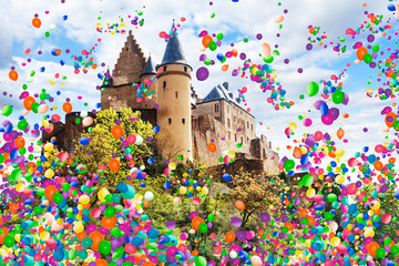 Vianden castle in Luxembourg with air balloons