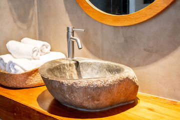 water tap with stone sink