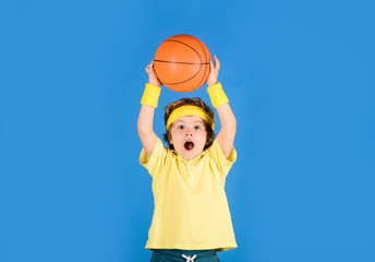 Little basketballer. Sports equipment. Active sports lifestyle. Basketball training game concept. Cute boy playing basketball. Enjoy sport game. Kid activities. Child boy in sportswear throws ball.