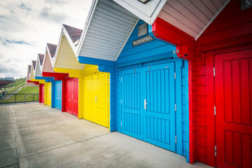 Bright, colorful beach huts in Whitby, England