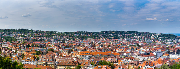 Germany, XXL panorama of stuttgart city district west houses and red roofs from above aerial view on sunny summer day with blue sky