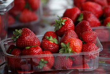 Strawberries are seen for sale on a fruit and vegetable stall at Alsager market, Stoke-on-Trent