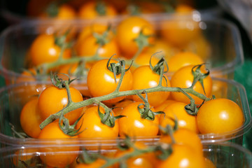 Yellow tomatoes are seen for sale on a fruit and vegetable stall at Alsager market, Stoke-on-Trent