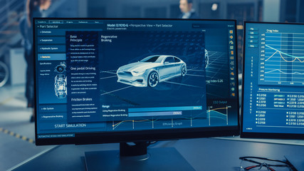 Professional Engineer Works on a Computer with a 3D CAD Software and Tests the Electric Car Chassis...