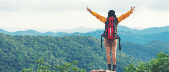 Women hiker or traveler with backpack adventure feeling victorious facing on the mountain, outdoor for education nature on vacation. Travel and Lifestyle Concept Fototapete